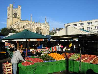 Cambridge market with Great St Mary's church in the background